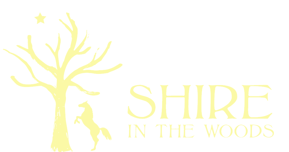 The Shire in the Woods logo
